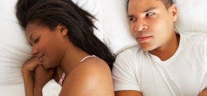 Couple in Bed Dealing With How to Deal With An Angry Spouse